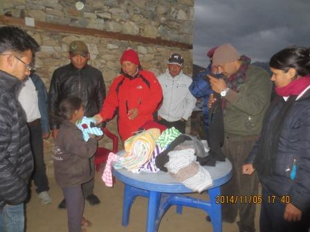Government officers distributing Warm clothes